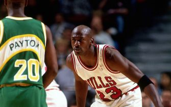 CHICAGO - 1996:  Michael Jordan #23 of the Chicago Bulls plays defense against Gary Payton of the Seattles Sonics during an NBA game at the United Center circa 1996 in Chicago, Illinois.  NOTE TO USER: User expressly acknowledges and agrees that, by downloading and or using this Photograph, user is consenting to the terms and conditions of the Getty Images License Agreement.  Mandatory Copyright Notice: Copyright 1996 NBAE (Photo by Scott Cunningham/NBAE via Getty Images)