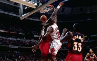 CHICAGO - 1997:  Michael Jordan #23 of the Chicago Bulls dunks against the Atlanta Hawks during Game Five, round two of the 1997 NBA Playoffs at the United Center in Chicago, Illinois.  NOTE TO USER: User expressly acknowledges and agrees that, by downloading and/or using this Photograph, User is consenting to the terms and conditions of the Getty Images License Agreement.  Mandatory Copyright Notice:  Copyright 1997 NBAE  (Photo by Scott Cunningham/NBAE via Getty Images)
