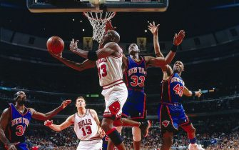 CHICAGO - MAY 14:  Michael Jordan #23 of the Chicago Bulls takes a reverse layup against Patrick Ewing #33 of the New York Knicks in Game five of the Eastern Conference Semifinals during the 1996 NBA Playoffs at the United Center on May 14, 1996 in Chicago, Illinois.  NOTE TO USER: User expressly acknowledges and agrees that, by downloading and/or using this Photograph, User is consenting to the terms and conditions of the Getty Images License Agreement.  Mandatory Copyright Notice:  Copyright 1996 NBAE  (Photo by Nathaniel S. Butler/NBAE via Getty Images)