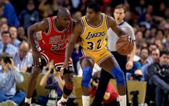 INGLEWOOD, CA - 1991:  Magic Johnson #32 of the Los Angeles Lakers posts up against Michael Jordan #23 of the Chicago Bulls during the 1991 NBA Finals played at the Great Western Forum in Inglewood, California. NOTE TO USER: User expressly acknowledges that, by downloading and or using this photograph, User is consenting to the terms and conditions of the Getty Images License agreement. Mandatory Copyright Notice: Copyright 1991 NBAE (Photo by Andrew D. Bernstein/NBAE via Getty Images)