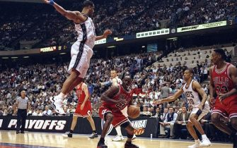 29 Apr 1998: Michael Jordan #23 of the Chicago Bulls in action against Jason Williams #55 of the New Jersey Nets during the NBA Playoffs round 3 game at the Continental Airlines Arena in East Rutherford, New Jersey. The Bulls defeated the Nets 116-101.