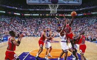 PHOENIX - JUNE 9: Michael Jordan #23 of the Chicago Bulls shoots a lay up during the game against the Phoenix Suns during Game One of the 1993 NBA Finals on June 9, 1993 at the America West Arena in Phoenix, Arizona. The Chicago Bulls won the game 100-92. NOTE TO USER: User expressly acknowledges and agrees that, by downloading and or using this photograph, User is consenting to the terms and conditions of the Getty Images License Agreement. Mandatory Copyright Notice: Copyright 1993 NBAE (Photo by Nathaniel S. Butler/NBAE via Getty Images)