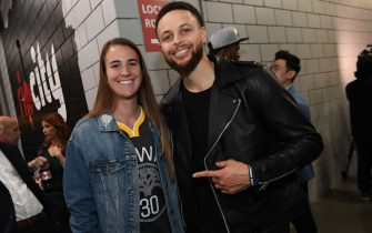 PORTLAND, OR - MAY 20: Stephen Curry #30 of the Golden State Warriors poses for a photo with Oregon Ducks Basketball player, Sabrina Ionescu, after advancing to the NBA Finals against the Portland Trail Blazers during Game Four of the Western Conference Finals on May 20, 2019 at the Moda Center in Portland, Oregon. NOTE TO USER: User expressly acknowledges and agrees that, by downloading and/or using this photograph, user is consenting to the terms and conditions of the Getty Images License Agreement. Mandatory Copyright Notice: Copyright 2019 NBAE (Photo by Noah Graham/NBAE via Getty Images)