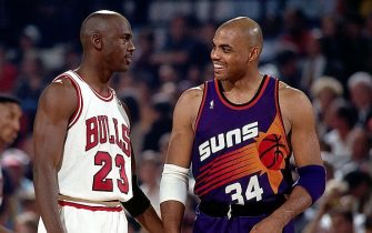 CHICAGO - JUNE 18:  Michael Jordan #23 of the Chicago Bulls talks to Charles Barkley #34 of the Phoenix Suns during Game Five of the 1993 NBA Championship Finals at Chicago Stadium on June 18, 1993 in Chicago, Illinois.  The Suns won 108-98, sending them home to Phoenix with 2 games to 3.  NOTE TO USER: User expressly acknowledges and agrees that, by downloading and/or using this Photograph, User is consenting to the terms and conditions of the Getty Images License Agreement  Mandatory Copyright Notice:  Copyright 1993 NBAE   (Photo by Andrew D. Bernstein/NBAE via Getty Images)