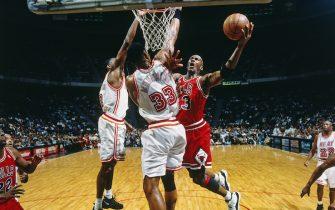 MIAMI, FL - APRIL 2, 1996:  Michael Jordan #23 of the Chicago Bulls shoots against Alonzo Mourning #33 of the Miami Heat on April 2, 1996 at Miami Arena in Miami, Florida. NOTE TO USER: User expressly acknowledges and agrees that, by downloading and/or using this Photograph, user is consenting to the terms and conditions of the Getty Images License Agreement. Mandatory Copyright Notice: Copyright 1996 NBAE  (Photo by Richard Lewis/NBAE via Getty Images)