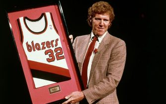 PORTLAND - 1990: Bill Walton #32 of the Portland Trailblazers has his jersey retired prior to the NBA game in Portland, Oregon. NOTE TO USER: User expressly acknowledges and agrees that, by downloading and or using this photograph, User is consenting to the terms and conditions of the Getty Images License Agreement. (Photo by NBA Photo Library/NBAE via Getty Images)