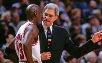 CHICAGO, IL - DECEMBER 17: Michael Jordan #23 of the Chicago Bulls is seen talking to Head Coach Phil Jackson of the Chicago Bulls during the game against the Los Angeles Lakers on December 17, 1997 at the United Center in Chicago, Illinois. NOTE TO USER: User expressly acknowledges and agrees that, by downloading and or using this Photograph, user is consenting to the terms and conditions of the Getty Images License Agreement. Mandatory Copyright Notice: Copyright 1997 NBAE (Photo by Andrew D. Bernstein/NBAE via Getty Images)