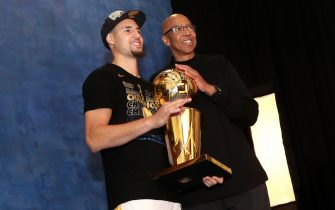 CLEVELAND,OH - Klay of the Golden State Warriors poses with his father Mychal Thompson for a portrait with the Larry O'Brien Championship trophy after defeating the Cleveland Cavaliers after Game Four of the 2018 NBA Finals on June 8, 2018 at Quicken Loans Arena in Cleveland, Ohio. NOTE TO USER: User expressly acknowledges and agrees that, by downloading and/or using this photograph, user is consenting to the terms and conditions of the Getty Images License Agreement. Mandatory Copyright Notice: Copyright 2018 NBAE (Photo by Joe Murphy/NBAE via Getty Images)