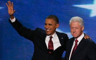 CHARLOTTE, NC - SEPTEMBER 05:  U.S. President Bill Clinton stands with Democratic presidential candidate, U.S. President Barack Obama (L) on stage during day two of the Democratic National Convention at Time Warner Cable Arena on September 5, 2012 in Charlotte, North Carolina. The DNC that will run through September 7, will nominate U.S. President Barack Obama as the Democratic presidential candidate.  (Photo by Alex Wong/Getty Images)