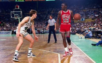 BOSTON - APRIL 17:  Michael Jordan #23 of the Chicago Bulls moves the ball against Danny Ainge #44 of the Boston Celtics in Game One of the Eastern Conference Quarterfinals during the 1986 NBA Playoffs on April 17, 1986 at the Boston Garden in Boston, Massachusetts. The Boston Celtics defeated the Chicago Bulls 123-104 and won the series 3-0. NOTE TO USER: User expressly acknowledges and agrees that, by downloading and or using this photograph, User is consenting to the terms and conditions of the Getty Images License Agreement. Mandatory Copyright Notice: Copyright 1986 NBAE (Photo by Dick Raphael/NBAE via Getty Images)