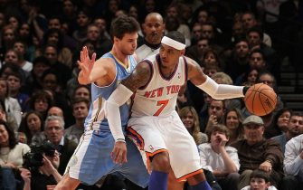 NEW YORK, NY - JANUARY 21:  (NEW YORK DAILIES OUT)  Carmelo Anthony #7 of the New York Knicks in action Danilo Gallinari #8 of the Denver Nuggets on January 21, 2012 at Madison Square Garden in New York City. The Nuggets defeated the Knicks 119-114. NOTE TO USER: User expressly acknowledges and agrees that, by downloading and/or using this Photograph, user is consenting to the terms and conditions of the Getty Images License Agreement.  (Photo by Jim McIsaac/Getty Images)