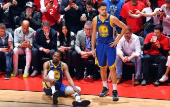 TORONTO, CANADA - JUNE 10: Kevin Durant #35 of the Golden State Warriors reacts to his leg injury during a game against the Toronto Raptors during Game Five of the NBA Finals on June 10, 2019 at Scotiabank Arena in Toronto, Ontario, Canada. NOTE TO USER: User expressly acknowledges and agrees that, by downloading and/or using this photograph, user is consenting to the terms and conditions of the Getty Images License Agreement. Mandatory Copyright Notice: Copyright 2019 NBAE (Photo by Jesse D. Garrabrant/NBAE via Getty Images)