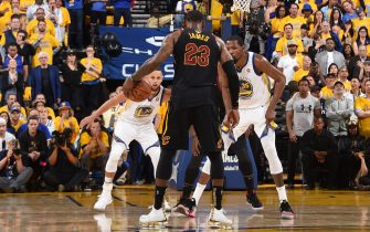 OAKLAND, CA - MAY 31: LeBron James #23 of the Cleveland Cavaliers handles the ball against Stephen Curry #30 and Kevin Durant #35 of the Golden State Warriors in Game One of the 2018 NBA Finals on May 31, 2018 at ORACLE Arena in Oakland, California. NOTE TO USER: User expressly acknowledges and agrees that, by downloading and or using this photograph, user is consenting to the terms and conditions of Getty Images License Agreement. Mandatory Copyright Notice: Copyright 2018 NBAE (Photo by Andrew D. Bernstein/NBAE via Getty Images)