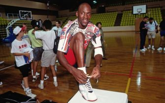 BARCELONA, SPAIN - 1992:  Michael Jordan ties his shoe at the 1992 Summer Olympics in Barcelona, Spain circa 1992. NOTE TO USER: User expressly acknowledges and agrees that, by downloading and or using this photograph, User is consenting to the terms and conditions of the Getty Images License Agreement. Mandatory Copyright Notice: Copyright 1992 NBAE (Photo by Andrew D. Bernstein/NBAE via Getty Images)