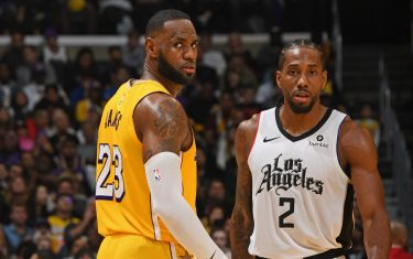 LOS ANGELES, CA - DECEMBER 25: LeBron James #23 of the Los Angeles Lakers and Kawhi Leonard #2 of the LA Clippers walk up court on December 25, 2019 at STAPLES Center in Los Angeles, California. NOTE TO USER: User expressly acknowledges and agrees that, by downloading and/or using this Photograph, user is consenting to the terms and conditions of the Getty Images License Agreement. Mandatory Copyright Notice: Copyright 2019 NBAE (Photo by Andrew D. Bernstein/NBAE via Getty Images)