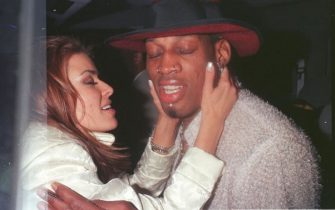 373750 01: 2/26/99 Beverly Hills, CA. New Laker Dennis Rodman celebrates his first winning game out on the town at GOODBAR with wife Carmen Electra.