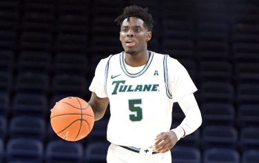 WASHINGTON, DC - DECEMBER 20:  Teshaun Hightower #5 of the Tulane Green Wave dribbles up court during a first round DC Holiday Fest college basketball game against the Akron Zips at the Entertainment & Sports Arena on December 20, 2019 in Washington, DC.  (Photo by Mitchell Layton/Getty Images)