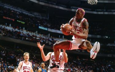 CHICAGO - MARCH 22: Dennis Rodman #91 of the Chicago Bulls rebounds  during a game played on March 22, 1997 at the United Center in Chicago, Illinois. NOTE TO USER: User expressly acknowledges and agrees that, by downloading and/or using this photograph, user is consenting to the terms and conditions of the Getty Images License Agreement.  Mandatory Copyright Notice: Copyright 1997 NBAE (Photo by Nathaniel S. Butler/NBAE via Getty Images)