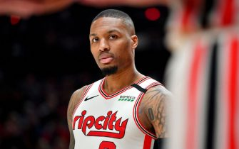 PORTLAND, OREGON - MARCH 04: Damian Lillard #0 of the Portland Trail Blazers looks on during the second half of the game against the Washington Wizards at the Moda Center on March 04, 2020 in Portland, Oregon. The Portland Trail Blazers topped the Washington Wizards, 125-105. (Photo by Alika Jenner/Getty Images)