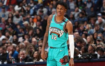 MEMPHIS, TN - JANUARY 17: Ja Morant #12 of the Memphis Grizzlies looks on during the game against the Cleveland Cavaliers on January 17, 2020 at FedExForum in Memphis, Tennessee. NOTE TO USER: User expressly acknowledges and agrees that, by downloading and or using this photograph, User is consenting to the terms and conditions of the Getty Images License Agreement. Mandatory Copyright Notice: Copyright 2020 NBAE (Photo by Joe Murphy/NBAE via Getty Images)