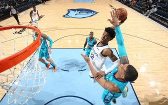 MEMPHIS, TN - OCTOBER 14: Ja Morant #12 of the Memphis Grizzlies dunks the ball against the Charlotte Hornets during a pre-season game on October 14, 2019 at FedExForum in Memphis, Tennessee. NOTE TO USER: User expressly acknowledges and agrees that, by downloading and or using this photograph, User is consenting to the terms and conditions of the Getty Images License Agreement. Mandatory Copyright Notice: Copyright 2019 NBAE (Photo by Joe Murphy/NBAE via Getty Images)