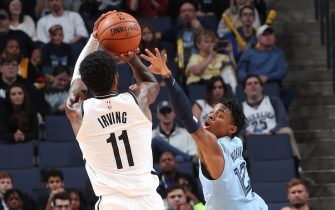 MEMPHIS, TN - OCTOBER 27: Ja Morant #12 of the Memphis Grizzlies attempts to block the shot from Kyrie Irving #11 of the Brooklyn Nets on October 27, 2019 at FedExForum in Memphis, Tennessee. NOTE TO USER: User expressly acknowledges and agrees that, by downloading and or using this photograph, User is consenting to the terms and conditions of the Getty Images License Agreement. Mandatory Copyright Notice: Copyright 2019 NBAE (Photo by Joe Murphy/NBAE via Getty Images)