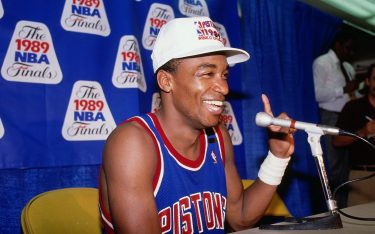 INGLEWOOD, CA - JUNE 13: Isiah Thomas #11 of the Detroit Pistons speaks to the media after defeating the Los Angeles Lakers in four games to win the NBA Championship on June 13, 1989 at Great Western Forum in Inglewood, California . NOTE TO USER: User expressly acknowledges and agrees that, by downloading and/or using this photograph, user is consenting to the terms and conditions of the Getty Images License Agreement.  Mandatory Copyright Notice: Copyright 1989 NBAE (Photo by Nathaniel S. Butler/NBAE via Getty Images)
