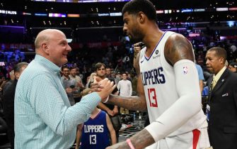 LOS ANGELES, CA - NOVEMBER 20: Paul George #13 of the Los Angeles Clippers is congratulated by owner owner Steve Ballmer after an overtime win over Boston Celtics, 107-104, at Staples Center on November 20, 2019 in Los Angeles, California. NOTE TO USER: User expressly acknowledges and agrees that, by downloading and/or using this Photograph, user is consenting to the terms and conditions of the Getty Images License Agreement. (Photo by Kevork Djansezian/Getty Images)