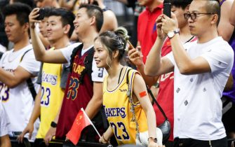 SHENZHEN, CHINA - OCTOBER 12: Supporters of the Los Angeles Lakers react during the match against the Brooklyn Nets during a preseason game as part of 2019 NBA Global Games China at Shenzhen Universiade Center on October 12, 2019 in Shenzhen, Guangdong, China. (Photo by Zhong Zhi/Getty Images)