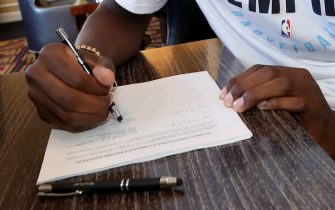SALT LAKE CITY, UT - JULY 1:  Jaren Jackson Jr. signs his NBA Contract with the Memphis Grizzlies on July 1, 2018 at Hotel Monaco in Salt Lake City, Utah. NOTE TO USER: User expressly acknowledges and agrees that, by downloading and or using this photograph, User is consenting to the terms and conditions of the Getty Images License Agreement. Mandatory Copyright Notice: Copyright 2018 NBAE (Photo by Joe Murphy/NBAE via Getty Images)