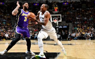 SAN ANTONIO, TX - NOVEMBER 3: DeMar DeRozan #10 of the San Antonio Spurs drives to the basket against Anthony Davis #3 of the Los Angeles Lakers on November 3, 2019 at the AT&T Center in San Antonio, Texas. NOTE TO USER: User expressly acknowledges and agrees that, by downloading and or using this photograph, user is consenting to the terms and conditions of the Getty Images License Agreement. Mandatory Copyright Notice: Copyright 2019 NBAE (Photos by Logan Riely/NBAE via Getty Images)
