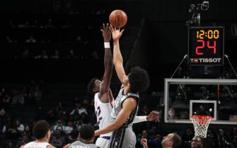 BROOKLYN, NY - FEBRUARY 3: Jarrett Allen #31 of the Brooklyn Nets jumps during the opening tip-off during the game against the Phoenix Suns on February 3, 2020 at Barclays Center in Brooklyn, New York. NOTE TO USER: User expressly acknowledges and agrees that, by downloading and or using this Photograph, user is consenting to the terms and conditions of the Getty Images License Agreement. Mandatory Copyright Notice: Copyright 2020 NBAE (Photo by Nathaniel S. Butler/NBAE via Getty Images)