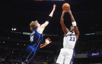 WASHINGTON D..C. - FEBRUARY 23:  Michael Jordan #23 of the Washington Wizards takes the jump shot against Dirk Nowitzki #41 of the Dallas Mavericks during the game at MCI Center on February 25, 2003 in Washington D.C. The Mavericks defeated the Wizards (in overtime)106-101.  NOTE TO USER: User expressly acknowledges and agrees that, by downloading and/or using this Photograph, User is consenting to the terms and conditions of the Getty Images License Agreement. Mandatory copyright notice: 2003 NBAE.  (Photo by:  Nathaniel S. Butler/NBAE via Getty Images)