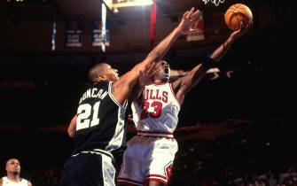 NEW YORK CITY - FEBRUARY 8: Michael Jordan #23 of the Chicago Bulls shoots against Tim Duncan #21 of the San Antonio Spurs during the 1998 NBA All-Star Game played on February 8, 1998 at Madison Square Garden in New York City. NOTE TO USER: User expressly acknowledges and agrees that, by downloading and or using this photograph, User is consenting to the terms and conditions of the Getty Images License Agreement. Mandatory Copyright Notice: Copyright 1998 NBAE (Photo by Steve Freeman/NBAE via Getty Images)
