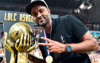 Lyon-Villeurbanne's French President Tony Parker poses next to the trophy as he celebrates after his team won the 5th leg of the French Elite championship final basketball match between Monaco (AS Monaco) and Lyon-Villeurbanne (ASVEL) at the Astroballe arena in Villeurbanne, on June 25, 2019. (Photo by ROMAIN LAFABREGUE / AFP)        (Photo credit should read ROMAIN LAFABREGUE/AFP via Getty Images)