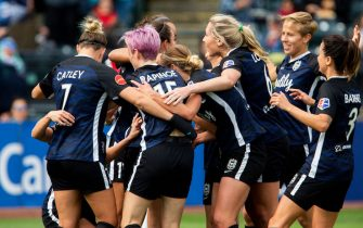 TACOMA, WA - SEPTEMBER 29:  Reign FC, including Steph Catley #7, Megan Rapinoe #15 and Allie Long #6 celebrate the goal by Jodie Taylor #9 against the Portland Thorns in the first half of the game at Cheney Stadium on September 29, 2019 in Tacoma, Washington. (Photo by Lindsey Wasson/Getty Images)