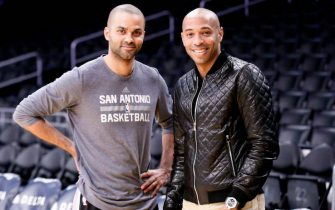 LOS ANGELES, CA - FEBRUARY 19:  Tony Parker #9 of the San Antonio Spurs poses for a photo with soccer player Thierry Henry prior to the game against the Los Angeles Lakers on February 19, 2016 at the Staples Center in Los Angeles, California . NOTE TO USER: User expressly acknowledges and agrees that, by downloading and/or using this Photograph, user is consenting to the terms and conditions of the Getty Images License Agreement. Mandatory Copyright Notice: Copyright 2016 NBAE (Photo by Chris Elise/NBAE via Getty Images)