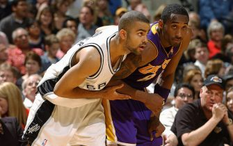 SAN ANTONIO - MAY 13:  Tony Parker #9 of the San Antonio Spurs defends Kobe Bryant #8 of the Los Angeles Lakers in Game five of the Western Conference Semifinals during the 2004 NBA Playoffs at Staples Center on May 13, 2004 in San Antonio, Texas.  The Lakers won 74-73.  NOTE TO USER: User expressly acknowledges and agrees that, by downloading and/or using this Photograph, user is consenting to the terms and conditions of the Getty Images License Agreement.  Mandatory Copyright Notice: Copyright 2004 NBAE (Photo by Andrew D. Bernstein/NBAE via Getty Images)
