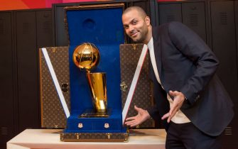 PARIS, FRANCE - JANUARY 22:  NBA Legend, Tony Parker poses for a photo next to the Louis Vuitton trunk for the Larry O'Brien Trophy during the Louis Vuitton Announcement Party as part of NBA Paris Games 2020 on January 22, 2020 in Paris, France at LVMH Headquarters. NOTE TO USER: User expressly acknowledges and agrees that, by downloading and/or using this Photograph, user is consenting to the terms and conditions of the Getty Images License Agreement. Mandatory Copyright Notice: Copyright 2020 NBAE (Photo by Alain Gadoffre/NBAE via Getty Images)