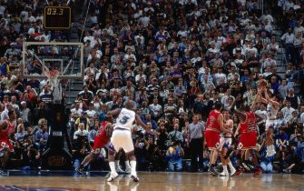 SALT LAKE CITY - JUNE 3:  John Stockton #12 of the Utah Jazz shoots a jump shot from the corner against Michael Jordan #23 of the Chicago Bulls in Game One of the 1998 NBA Finals at the Delta Center on June 3, 1998 in Salt Lake City, Utah.  The Jazz won 88-85 in overtime.  NOTE TO USER: User expressly acknowledges that, by downloading and or using this photograph, User is consenting to the terms and conditions of the Getty Images License agreement. Mandatory Copyright Notice: Copyright 1998 NBAE (Photo by Nathaniel S. Butler/NBAE via Getty Images)