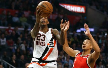 LOS ANGELES, CALIFORNIA - DECEMBER 03:  Lou Williams #23 of the Los Angeles Clippers goes up for a shot as CJ McCollum #3 of the Portland Trail Blazers defends during the first half at Staples Center on December 03, 2019 in Los Angeles, California. NOTE TO USER: User expressly acknowledges and agrees that, by downloading and or using this photograph, User is consenting to the terms and conditions of the Getty Images License Agreement. (Photo by Katharine Lotze/Getty Images)