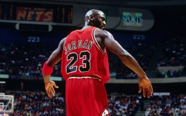 EAST RUTHERFORD, NJ - JANUARY 23: Michael Jordan #23 of the Chicago Bulls walks during a game played on January 23, 1997 at the Continental Airlines Arena in East Rutherford, New Jersey. NOTE TO USER: User expressly acknowledges and agrees that, by downloading and or using this photograph, User is consenting to the terms and conditions of the Getty Images License Agreement. Mandatory Copyright Notice: Copyright 1997 NBAE (Photo by Nathaniel S. Butler/NBAE via Getty Images)