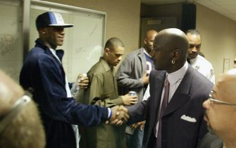 CLEVELAND - APRIL 8:  High school phenomenon LeBron James #23 of the St. Vincent-St. Mary Fighting Irish shakes hands with Michael Jordan #23 of the Washington Wizards after Jordan's game against the Cleveland Cavaliers at Gund Arena on April 8, 2003 in Cleveland, Ohio.  The Wizards won 100-91.  NOTE TO USER: User expressly acknowledges and agrees that, by downloading and/or using this Photograph, User is consenting to the terms and conditions of the Getty Images License Agreement.  Copyright 2003 NBAE  (Photo by David Liam Kyle/NBAE via Getty Images)