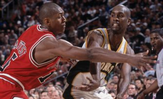 2 Feb 2002:  Point guard Gary Payton #20 of the Seattle SuperSonics passes the ball as guard Ron Artest #15 of the Chicago Bulls plays defense during the NBA game at Key Arena in Seattle, Washington.  The Bulls defeated the SuperSonics 97-91.  NOTE TO USER: User expressly acknowledges and agrees that, by downloading and/or using this Photograph, User is consenting to the terms and conditions of the Getty Images License Agreement. Mandatory copyright notice: Copyright 2002 NBAE Mandatory Credit: Sam Forencich/NBAE/Getty Images