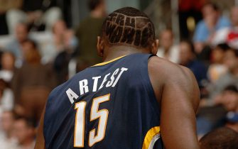 """LOS ANGELES - NOVEMBER 27:  Ron Artest #15 of the Indiana Pacers is seen on court with the words """"Tru Warier"""" (the name of Artest's record label) shaved in the back of his head against the Los Angeles Clippers November 27, 2005 at Staples Center in Los Angeles, California. The Pacers won 97-92.  NOTE TO USER: User expressly acknowledges and agrees that, by downloading and/or using this Photograph, user is consenting to the terms and conditions of the Getty Images License Agreement. Mandatory Copyright Notice: Copyright 2005 NBAE (Photo by Noah Graham/NBAE via Getty Images)"""
