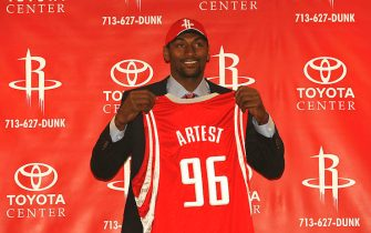 HOUSTON - August 25:  Houston Rockets Ron Artest poses with his jersey during his press conference August 25, 2008 at the Toyota Center in Houston, Texas. Artest was traded from The Sacramento Kings earlier this month.  NOTE TO USER:User expressly acknowleges and agrees that, by downloading and/or using this Photograph, user is consenting to the terms and conditions of the Getty Images License Agreement. (Photo by Bill Baptist/NBAE via Getty Images)