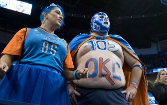 OKLAHOMA CITY, OK - OCTOBER 19: Basketball fans cheer for the Oklahoma City Thunder during the first half of a NBA  game against the New York Knicks  at the Chesapeake Energy Arena on October 19, 2017 in Oklahoma City, Oklahoma. NOTE TO USER: User expressly acknowledges and agrees that, by downloading and or using this photograph, User is consenting to the terms and conditions of the Getty Images License Agreement. (Photo by J Pat Carter/Getty Images) *** Local Caption *** ;