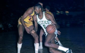 BOSTON, MA - 1964: Bill Russell #6 of the Boston Celtics handles the ball against the San Francisco Warriors circa 1964 at the Boston Garden in Boston, Massachusetts. NOTE TO USER: User expressly acknowledges and agrees that, by downloading and/or using this photograph, user is consenting to the terms and conditions of the Getty Images License Agreement. Mandatory Copyright Notice: Copyright 1964 NBAE (Photo by Dick Raphael/NBAE via Getty Images)