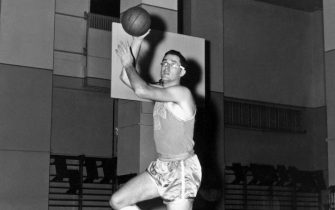 MINNEAPOLIS, MN - 1955:  George Mikan #99 of the Minneapolis Lakers poses for a mock action portrait in 1955 in Minneapolis, Minnesota.  NOTE TO USER: User expressly acknowledges and agrees that, by downloading and or using this photograph, User is consenting to the terms and conditions of the Getty Images License Agreement.  Mandatory Copyright Notice:  Copyright 1955 NBAE (Photo by NBA Photos/NBAE via Getty Images)