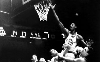 PHILADELPHIA - 1960:  Wilt Chamberlain #13 of the Philadelphia Warriors shoots a layup against the Detroit Pistons during an NBA game circa 1960 played in Philadelphia, Pennsylvania.  NOTE TO USER: User expressly acknowledges that, by downloading and or using this photograph, User is consenting to the terms and conditions of the Getty Images License agreement. Mandatory Copyright Notice: Copyright 1960 NBAE (Photo by NBA Photo Library/NBAE via Getty Images)